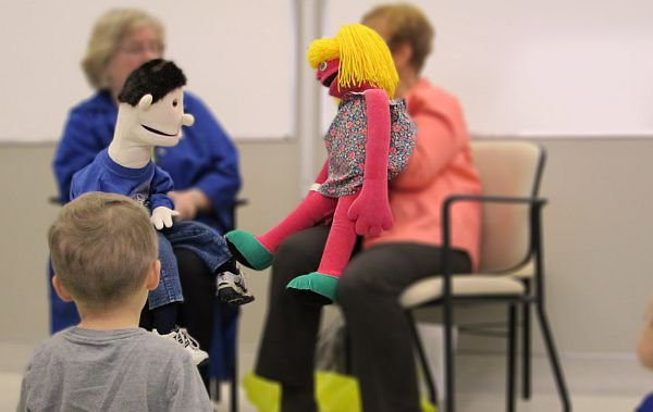 Children learning with the help of puppets