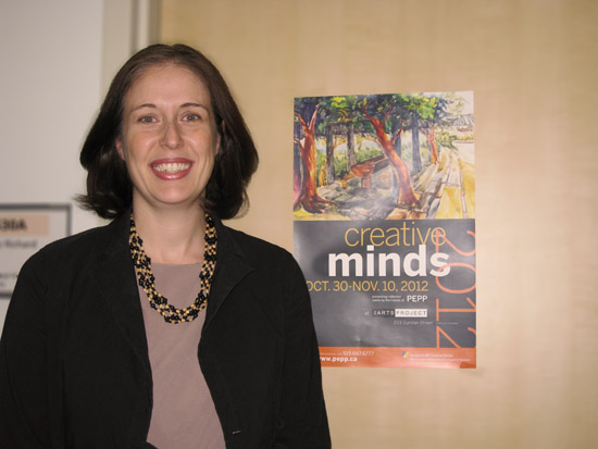 Dr. Julie Richard with Creative Minds poster