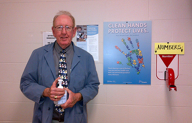 Bill Gawley with hand sanitizer