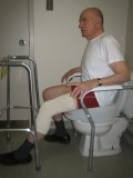 sitting on toilet